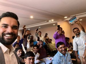 Karan Gupta taking a selfie with mobile repairing course completion winners
