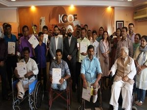 Karan Gupta presenting course completion certificates to KGEF mobile repairing course participants