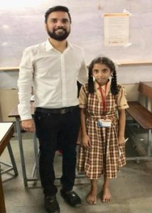 Karan Gupta with a school girl of Gandhi Memorial High School, Dharavi